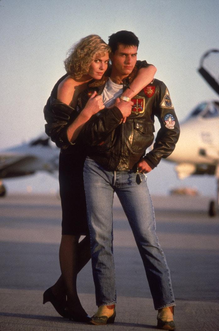 Том круз в куртке авиатор и Келли МакГиллис