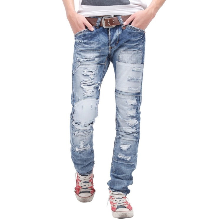 Стильные рваные джинсы с потертостями