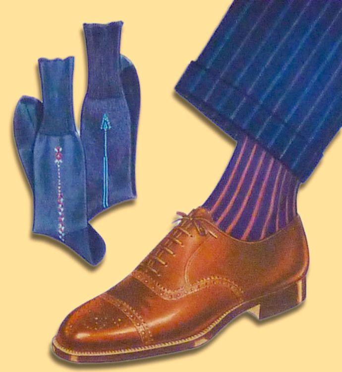 Ребристые красные и синие носки создают хорошую комбинацию между коричневыми туфлями и тёмным костюмом