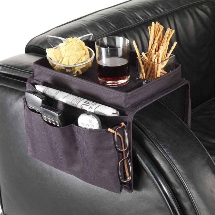 Ваш мужчина любит полежать на диване? Ему может пригодиться органайзер, который крепится на подлокотник и помогает держать под рукой пульт от телевизора, гаджеты, журналы и т.д.