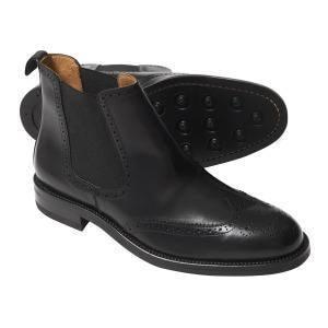 Черные ботинки челси в стиле броги